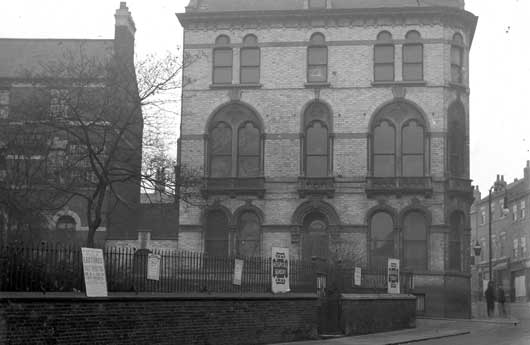 Micklegate Corner House, on the junction with St Martin's Lane. The adverts on the railings include one for a lecture by Dr Evelyn himself. Photograph: YAYAS, the Evelyn Collection