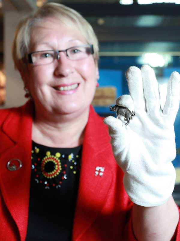 Cllr Sonja Crisp holds the silver boar badge at the Yorkshire Museum. Photograph: City of York Council