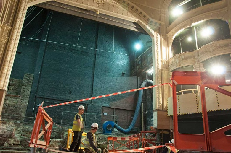 Archaeologists work under the shadow of the Theatre Royal arch