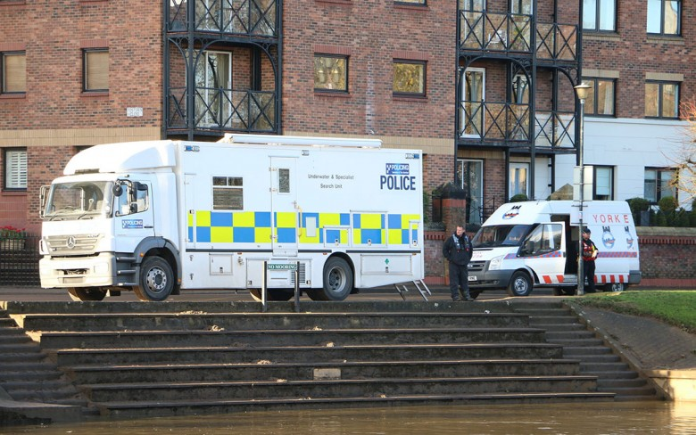 The police and York Rescue Boat  on the riverbank earlier this week in the search for Rory