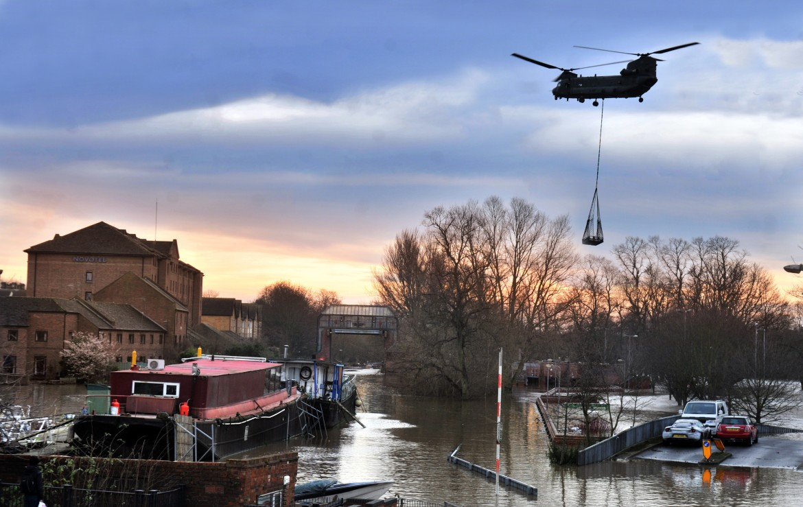 A Chinook helicopter hovers above Castle Mills Bridge in York as he delivers parts to repair the Foss barrier which failed causing widespread flooding in the city.Pic : Nigel Holland