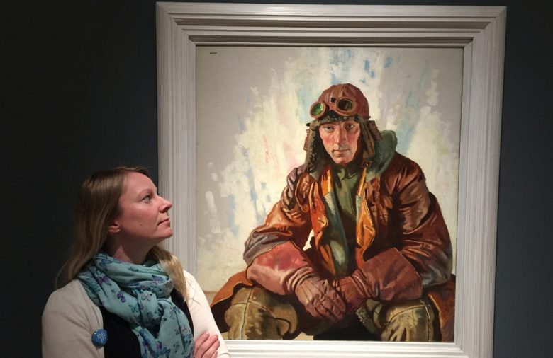 Assistant curator of art Lorna Hogger with The NCO Pilot by William Orpen. © IWM