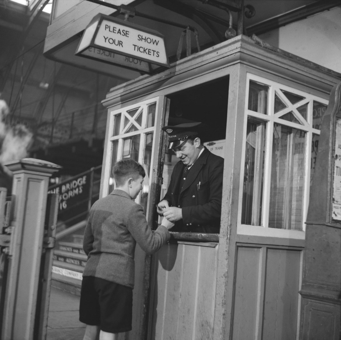 Tickets please: a young passenger heads off on his travels from York station in 1950