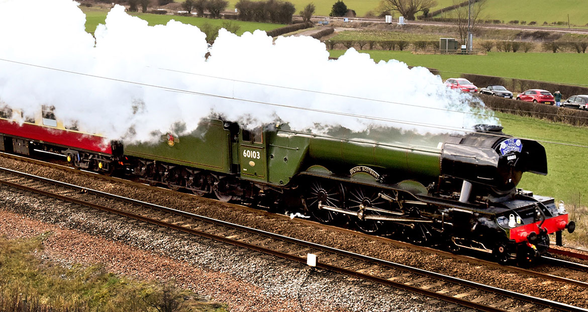 Flying again… Flying Scotsman going at full tilt along the East Coast Main Line at Colton Junction, just south of York. Photograph: Nigel Holland