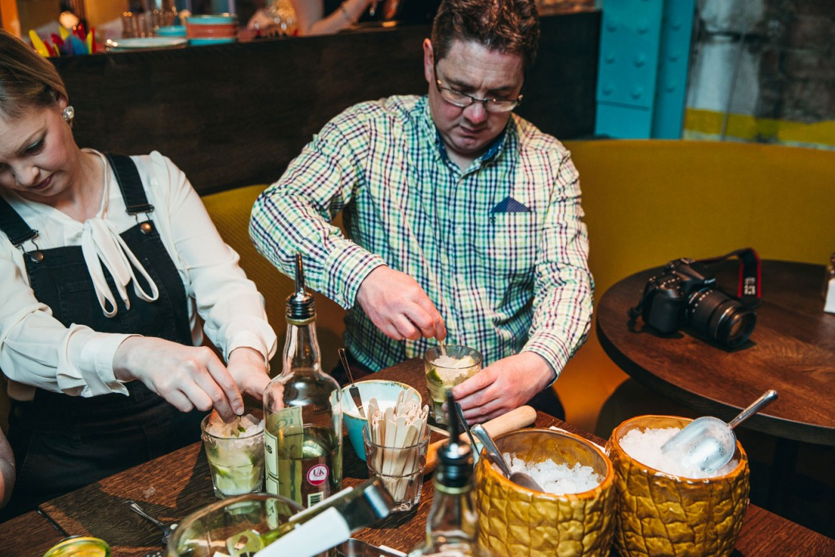 Our man Richard McDougall and wife Vanessa get to grips with caipirinhas. Photograph: Tom Joy Photography