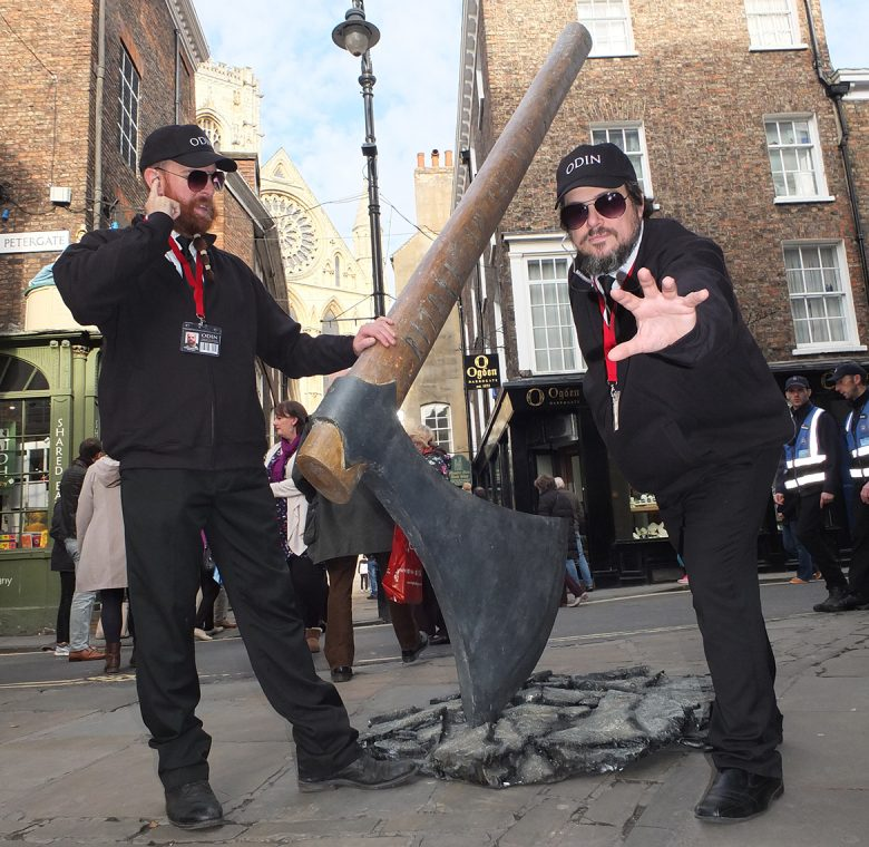 Agents of Odin investigate the giant axe buried in a York street. Photograph: Pyper York